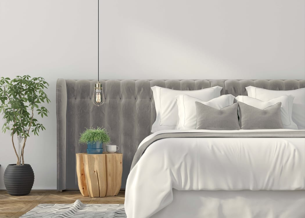 Moxy Interior - Wall mounted upholstered, luxury headboard with custom upholstered wall panels - Custom luxury, upholstered beds with high end, bedroom textiles   Blend Home Furnishings