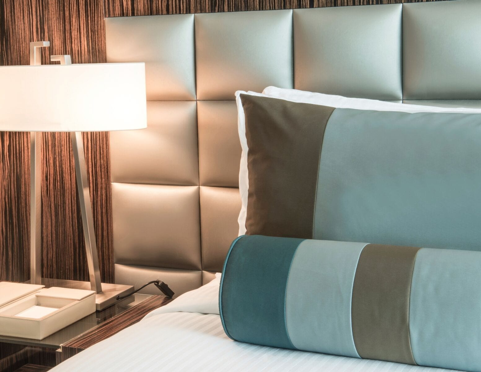 wall mounted headboards and custom upholstered bed